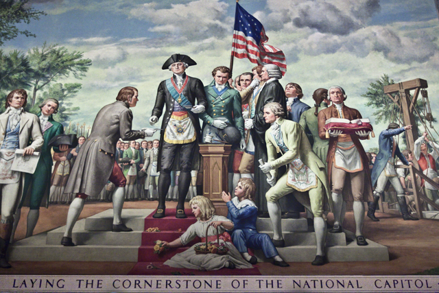 George Washington laying the cornerstone of the national capitol.